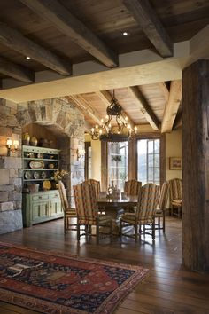 Wood ceiling, beams, stone, rustic timbers, mountain lodge, painted green cabinet.   Designed by Locati Interiors.