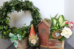 """While some gnomes like to travel, ours Freddy Flowers prefers to """"vacation"""" in the shop. Today he is frolicking among a beautiful ivy wreath and unique wood bird house plan. Either of these cuties would be perfect for a get well or """"have a great day"""" gift. Check back weekly to see where in the shop he is """"vacationing""""next ...."""