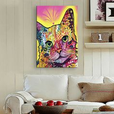 Canvas wall art with a graffiti-inspired cat motif.