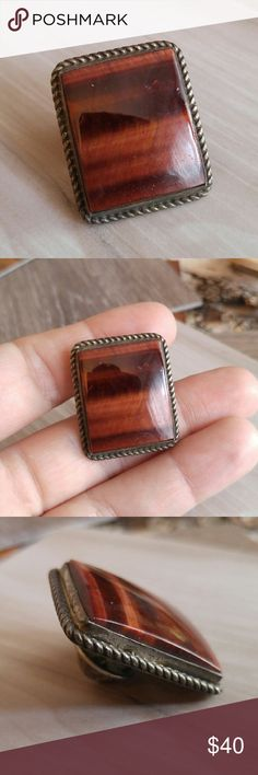 -sold- Vintage tiger eye pin brooch silver native  This wonderful pin is made of a fiery red tiger eye stone set in silver tone metal with a metal rope border. Rectangular shape. This pin can be worn by both nen and women. The metal seems like it may be sterling, but has not been tested and is not stamped or signed anywhere.The pin post is slightly bent but still works just like it should.Heavy tarnish patina FOXD8845TIG888 Vintage Jewelry Brooches
