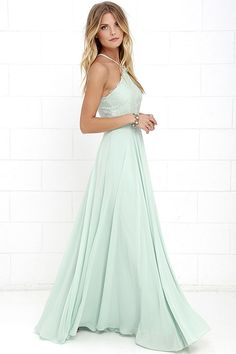 The Everlasting Enchantment Sage Green Maxi Dress will have admirers under your spell! Adjustable spaghetti straps support a lacy halter bodice, then crisscross at back. Layers of chiffon sprouts from a fitted waist, then sweeps down to an elegant maxi length. Hidden back zipper with clasp.