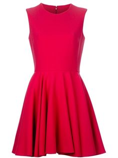 Red wool crepe sleeveless dress from Alexander McQueen  featuring a  high round neckline, flared A-line skirt and centre back concealed zip fastening. Fully lined.