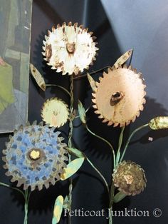 "Flower garden from used saw blades ... this upcycling project looks like ""an…"