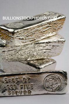 Stacked, shiny pure silver bullion ingots. Precious metal.
