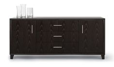 Arris Sideboard by Altura Furniture | Dennis Miller Associates. Veneer cabinet with profiled and mitred solid wood face frame. One centered 2-door compartment. One adjustable shelf. Two banks of two soft close drawers. Square tapered feet with levelers.