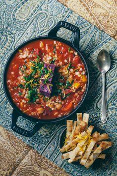 Vegan Mediterranean Harissa Stew with Purple Sweet Potato, served with crispy vegan lavash strips.