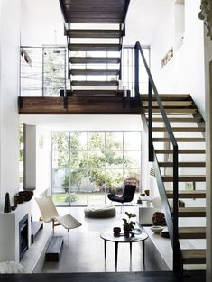 Good idea for a small space. Open staircase lets the light filter through, and the space doesn't feel cramped.