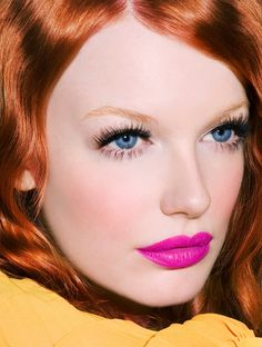 Amazing. Red hair. Pink lips. Blue eyes. Striking lashes. Perfect brows. Flawless skin.