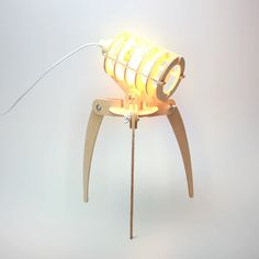 The inspiration of this lamp is from the movie named War of the World directed by Spielberg. As per its name, let the three legged lamp invade your table. It is