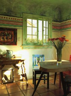 Greens and patterns in dining area. Mexican / Spanish style
