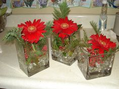 Red Gerbera daisy cluster with pepper berry and cedar greens.