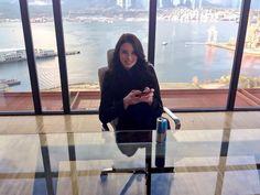 Rachel Nichols checks her phone from the set of Continuum: Piron offices. (via @SimonDavisBarry on Twitter)