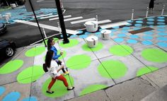 The latest weapon in Chicago's battle to make streets more pedestrian-friendly comes with bright blue and green polka dots. They're painted on the sidewalks and streets of the busy six-corner intersection of Southport, Lincoln and Wellington avenues.