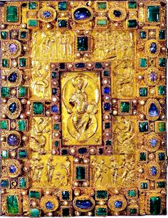 "'The Codex Aureus of St. Emmeram, 9th century illuminated Gospel Book. Gold cover with precious gemstones, sapphires, emeralds, and pearls. At the centre of the cover appears Christ in Majesty seated on the globe of the world and holding on his knee a book inscribed with the words ""I am the way, and the truth, and the life. No man cometh to the Father, but by me.""   Important example of Carolingian art, as well of one of very few surviving treasure bindings of this date. Precisely dated to…"
