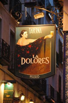 Madrid~ Sign for the Taberna La Dolores Pub Signs, Shop Signs, Places To Travel, Places To Go, Travel Destinations, Spain And Portugal, Street Signs, Hanging Signs, Spain Travel