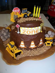 A pretty amazing 'construction zone' b-day cake... marshmallow 'boulders' You could so do this for Gage's birthday!