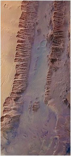 Valles Marineris on Mars stretches over 4000 km long and 200km wide, with a depth of 10km, and is believed to be the largest canyon in the Solar System. Image credit: ESA