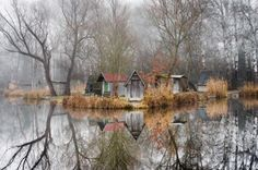 """The Hungarian settling of Sződliget is often called """"Witch Village"""" due to it's eerie atmosphere. It is a small waterside town with only a couple of inhabitants, and fog gathers on the lake most nights."""