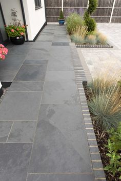 Want a modern, contemporary patio?Treat yourself to our high quality Brazilian Slate, which is hand selected from the quarry for the beauty of its naturally occurring tones. Featuring Riven slate in Olive Black & Beta Silver Haze Edging. Slate Garden, Slate Patio, Garden Tiles, Patio Tiles, Garden Paving, Patio Slabs, Garden Path, Back Gardens, Outdoor Gardens
