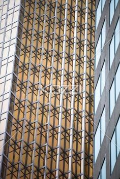 low angle view of a elegant commercial building. - Low angle shot of office building with steel frames.