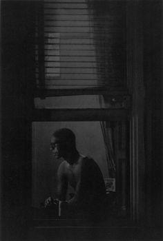 Roy DeCarava (1919-2009) - Man in window. New York, 1978. S)