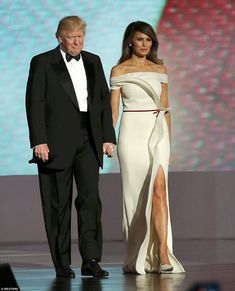 "Melania Trump at Inaugural Ball. No one has seen Melania since the inauguration, and Bill Maher wondered where she was. ""I'm not going to say we have a mad king with his queen locked in a tower, but it is called Trump Tower! She's like the Slovenian Rapunzel – she has to let her hair down!"""
