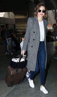 """If I'm going on a trip, I just take my carry-on with me because I don't want to check something in.""— Miranda Kerr On Miranda Kerr: Saint Laurent coat;Louis Vuitton luggage."