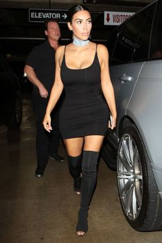 At the Revolve Social Club party in L.A., Kardashian debuted a custom pair of black Yeezy open-toe, over-the-knee boots. She paired the statement footwear with a matching Privacy Please dress and a denim choker.