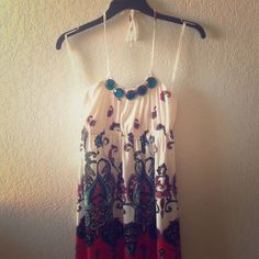 Colorful neck strap dress.  A very cute dress with colorful designs And Blue beads on the neckline. Size Small. In great condition. Wet Seal Dresses