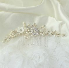 Arianna Bridal hair Comb Vintage inspired beautiful detailed bridal hair comb, lovingly handcrafted from shimmering crystals, freshwater pearls and white porcelain flowers, offering the perfect touch of sparkle and romance. #bridalhairaccessories #adrianasparksbridal