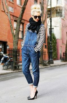 Blue overalls is paired with a striped button-up, black scarf, sunglasses and heels.