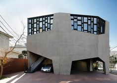 Hiroshi Nakamura creates warren-like car showroom and home