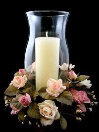 Silk flowers on centerpiece around hurricane lantern