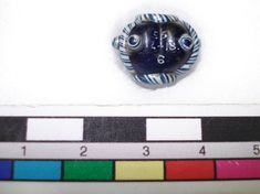 Glass bead, blue, trefoil with blue and white collars and similar ribs, each flanked by two bosses.