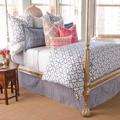Fresh and pretty with hand printed linens from johnrobshaw.com, a cool golden bed and barely there window treatments to keep it light and bright!