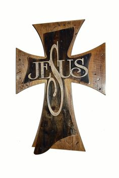 """A beautiful Jesus Cross. The cross is made out of 1/4"""" MDF and a laser cut detailed fireman badge cut out of baltic birch. It was hand painted in red, white and blue to represent American's colors and"""