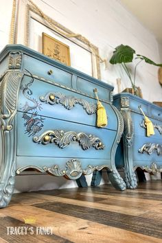 A pair of light blue bombay furniture nightstands with metallic gold accents & chinese drawings.. Click over to the blog for step-by-step instructions to paint this finish! Tracey Bellion #traceysfancy Tracey's Fancy Bombay Chest Blue Color Palette Blue Color Schemes Blue Furniture Paint Gold Accents For Bedroom Metallic Gold Paint Dixie Belle Paint Company Chalk Paint Dusty Blue Stormy Seas Fluff Best Dang Wax Caviar Honky Tonk Red Dixie Belle Paint, Blue Colour Palette, Painted End Tables, Metallic Gold Paint, Blue Color Schemes, Chalk Paint Furniture, Chalk, Blue Paint, Blue Painted Furniture