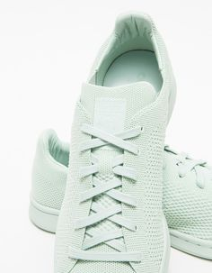 From Adidas, an updated classic sneaker in a mint Green. Features monochromatic color scheme, knit upper, flat cotton laces, branded tongue logo tab, leather lined heel and rubber sole.  •Classic sneaker in Green •Monochromatic color scheme •Knit u