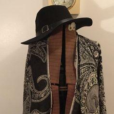 Wide rimmed black hat with belt buckle Polyester black wide rimmed hat, with accent belt buckle sewn around edge. Accessories Hats