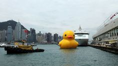 Rubber Duck,     Hong Kong 2013 14 x 15 x 16,5 meters Inflatable, pontoon & generator  The Rubber Duck knows no frontiers, it doesn't discriminate people and doesn't have a political connotation. The friendly, floating Rubber Duck has healing properties: it can relieve mondial tensions as well as define them. The rubber duck is soft, friendly and suitable for all ages!  The work has traversed global waters since 2007 - could be seen around the world.  By:  Florentijn Hofman