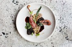 Roasted Squab with Morels and Ramps from Chef Jim Christiansen of Heyday in Minneapolis. Photographed by Eliesa Johnson for NY Magazine's Grubstreet.