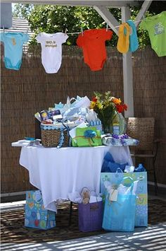 Baby Shower Ideas - Baby In Bloom, it s perfect for a boy or girl themed shower...love the onsies hanging!!