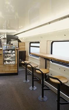 Starbucks, with the help of Swiss train company SBB, has converted a double-decker car running from Geneva Airport to St. Gallen in Switzerland into a fully functional Starbucks store, complete with wood tables, leather chairs, and, in another first for the company, waitstaff.