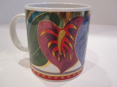 Make SURE gold is intact if Gift-Giving it.        Laurel Burch - Anthurium Mug - Multi Color Flowers With Gold Trim - GUC