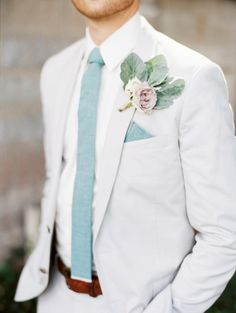 The light grey suite, white shirt and pale blue tie are perfect for a #winter #groom.