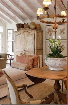 Love the urns atop the beautiful armoire.