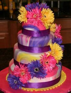 Tie Dyed Fondant Wedding Cake:  This tie dyed fondant wedding cake was created for a 60's/70's retro wedding (recommittment).  I took fondant in the wedding colors, cut it into chunks