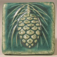 Along with many Pewabic tiles, the Pinecone is a reproduction of an original Stratton tile. It was designed by Mary Chase Stratton, circa for the fireplace in a private home on East Grand River Blvd in Detroit. Art Nouveau Tiles, Art Deco, Vintage Pottery, Pottery Art, Clay Crafts, Arts And Crafts, Pewabic Pottery, Craftsman Tile, Handmade Tiles