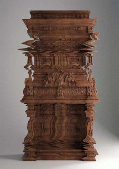 A PIECE OF FURNITURE CARVED TO LOOK LIKE A DIGITAL GLITCH (ARTIST UNKNOWN AT THIS TIME)