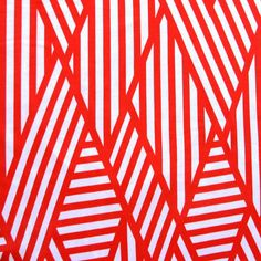 Quality white cotton lycra with red stripes in abstract blocking patterns printed on. Great stretch! Would make a lovely maxi skirt or wrap ...